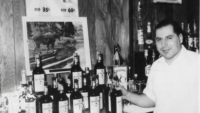 Tony Varavvas behind the bar at John's Bar & Grille in Canton. He died earlier this week at age 90.