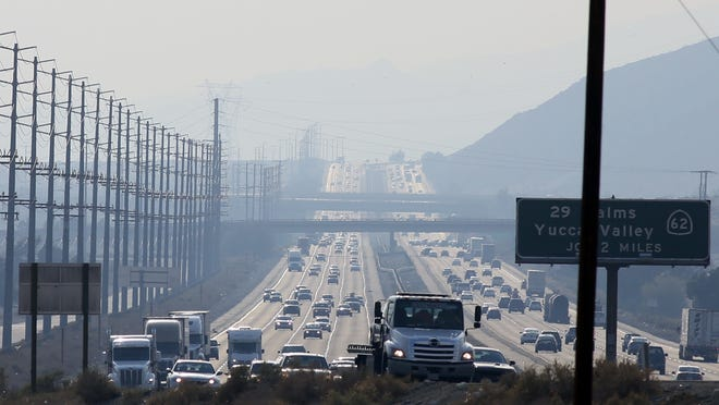 Traffic moves along Interstate 10 near Palm Springs, spewing carbon dioxide and other pollutants into the air.