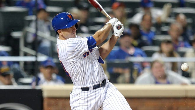 T.J. Rivera (54) hits an RBI infield single against the Philadelphia Phillies during the sixth inning at Citi Field.