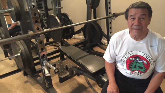 Ray Fougnier, 73, of Plymouth Township is a record-holding power lifter. Fougnier talked to Jim Schaefer about Fougnier's recent feats. Here he is in the basement workout area on his home.