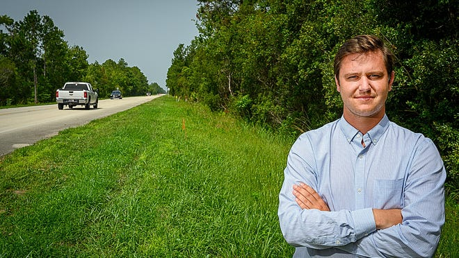 South Anastasia Communities Association President Keto Burns stands on the side of State Road 206, south of St. Augustine, on Friday near where the 999 home King's Grant development was proposed to be built.