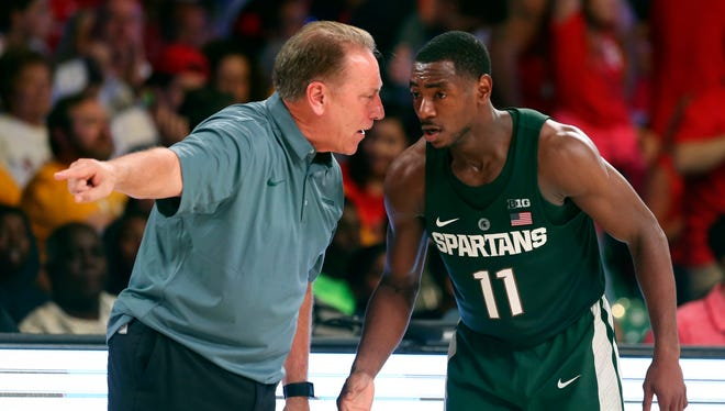 Michigan State coach Tom Izzo speaks with guard Lourawls Nairn Jr. (11) during the second half of MSU's 73-62 win Wednesday in Nassau, Bahamas.