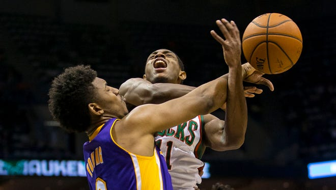 Milwaukee Bucks guard Brandon Knight (11) is fouled by Los Angeles Lakers forward Nick Young (0). The Bucks won 108-105.
