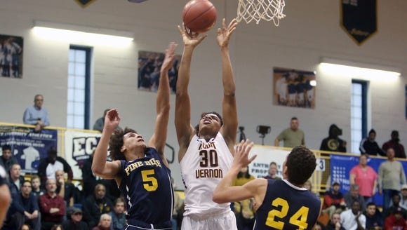 Mount Vernon's Troy Hupstead (30) puts up a shot against