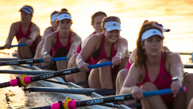 Lucie Heranova, center, strains during practice with the U of L rowing team on the Ohio River. May 10, 2018