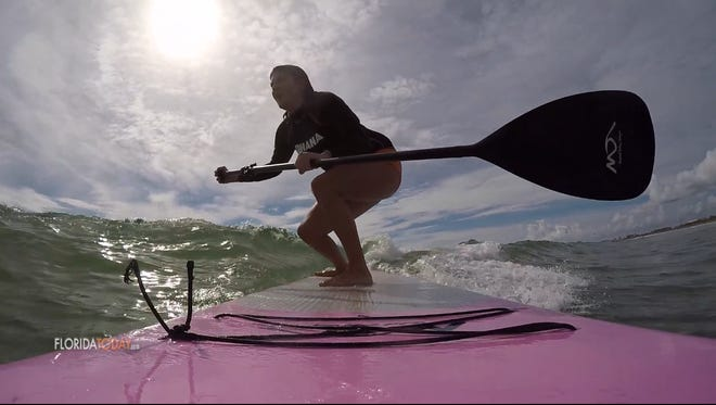 Michelle Mulak finds out that SUP surfing is harder than expected.