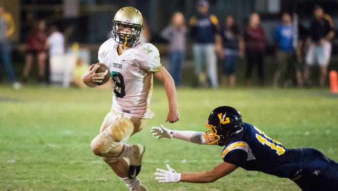 York Catholic's Kyle Dormer (9) evades a tackle from Littlestown's Memphis Stonesifer on Friday, Oct. 6, 2017. The Fighting Irish snapped the Bolts' five game winning streak with a 21-14 win.