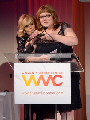Lindy West speaks onstage with Jane Fonda at the 2013 Women's Media Awards on October 8, 2013 in New York City.