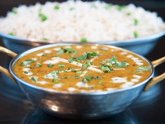 A steaming bowl of Dal Makhani is served with basmati rice at Monsoon Fine Indian Cuisine in Cherry Hill.