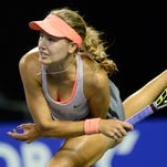 Eugenie Bouchard of Canada follows through on a serve during her victory Wednesday against Jelena Jankovic of Serbia.