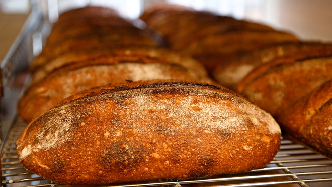 Loaves of bread cool before delivery at Noble Bread in Phoenix on January 29, 2016.