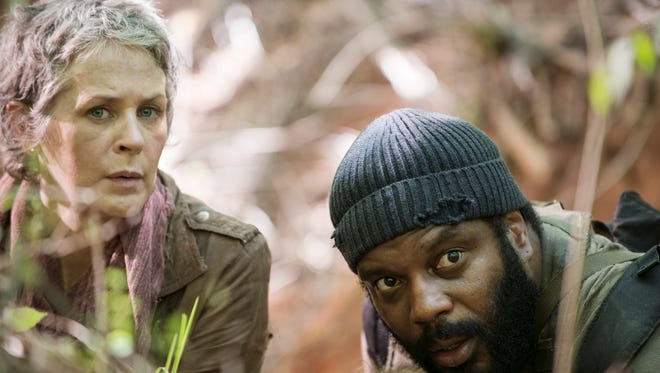 Carol (Melissa McBride), left, and Tyreese (Chad L.  Coleman) hide from walkers in Sunday's season premiere of AMC's 'The Walking Dead.'