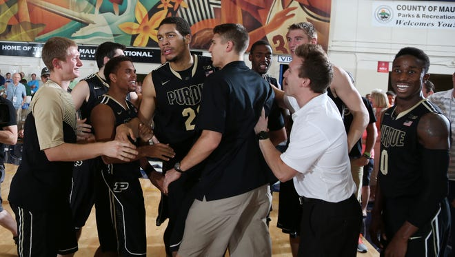 Purdue Boilermakers center A.J. Hammons (20) is congratulated by his teammates after making the game winning shot against the Brigham Young Cougars during the 2014 EA Sports Maui Invitational at the Lahaina Civic Center. Purdue defeats Brigham Young 87-85 in overtime.