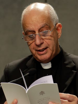 Monsignor Rino Fisichella reads an Apostolic Letter by Pope Francis during a press conference at the Vatican, Monday, Nov. 21, 2016.