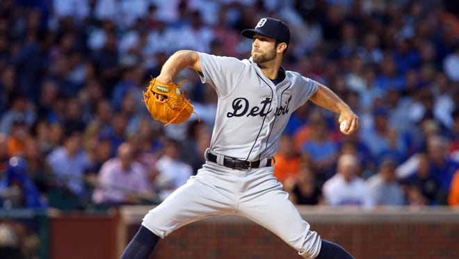 Detroit Tigers starting pitcher Daniel Norris throws a pitch against the Chicago Cubs during the first inning at Wrigley Field.