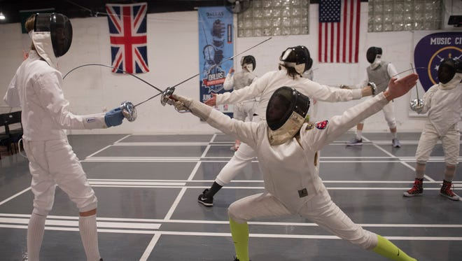 Roman Terry and Jenny Hall practice fencing at the Music City Fencing Club Thursday, Jan. 26, 2017, in Nashville, Tenn.