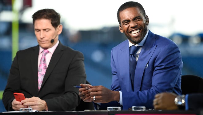 Monday Night Football sportscasters Randy Moss, right, and Steve Young chat before the Titans's game against the Colts at Nissan Stadium Monday, Oct. 16, 2017 in Nashville, Tenn.