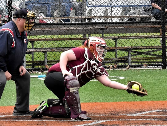 Western Hills catcher Joanna Wills squeezes a pitch