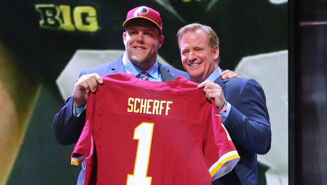 Former Iowa Hawkeye Brandon Scherff poses for a photo with NFL commissioner Roger Goodell after being selected as the fifth overall pick by the Washington Redskins in the first round of the 2015 NFL Draft.
