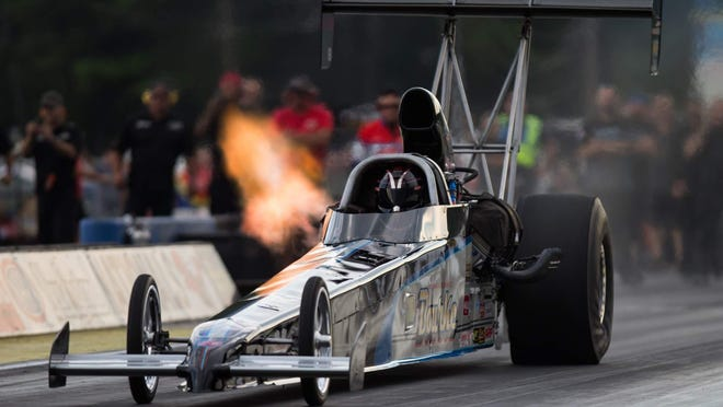 In this 2016 file photo, A Top Alcohol Dragster roars down the track at New England Dragway during an NHRA Lucas Oil Series regional event. The series returns to Epping this weekend with a new look due to the COVID-19 pandemic.