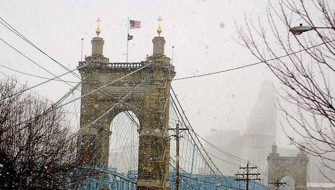 Flurries are in the forecast on Saturday but you can still bundle up and walk the bridges.
