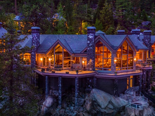 A night view of the main residence of Crystal Pointe, a Lake Tahoe estate for sale for $75 million. The estate offers more than 16,000 square feet of living space.