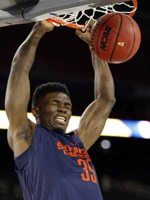 AP  Chinonso Obokoh,  dunking during practice at the Final Four in Houston, was listed as a junior on this season?s Orange roster. Syracuse's Chinonso Obokoh, who attended Bishop Kearney, dunks during practice at the 2016 NCAA Final Four.in Houston.