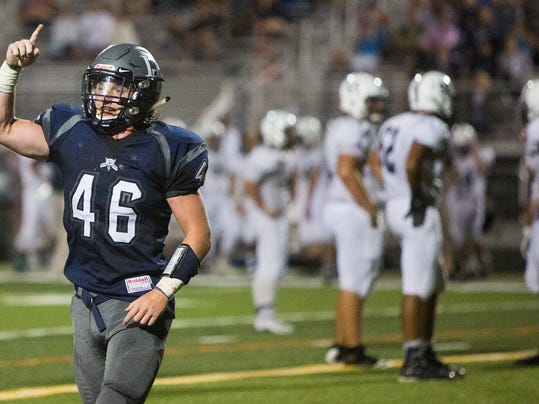 Dallastown defender Jake Garrity celebrates after the Wildcats  defense stopped West York on fourth down with just over a minute remaining during a Sept. 11 game at West York.