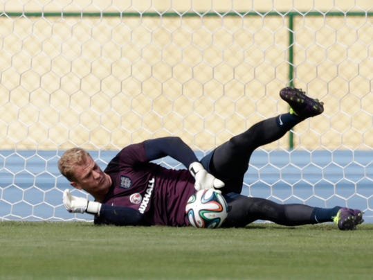 England's goalkeeper Joe Hart makes a save during a squad training session for the 2014 soccer World Cup at the Urca military base in Rio de Janeiro, Brazil, Wednesday, June 11, 2014.  The England soccer team are staying in Rio de Janeiro as their base city for the 2014 soccer World Cup.  (AP Photo/Matt Dunham)