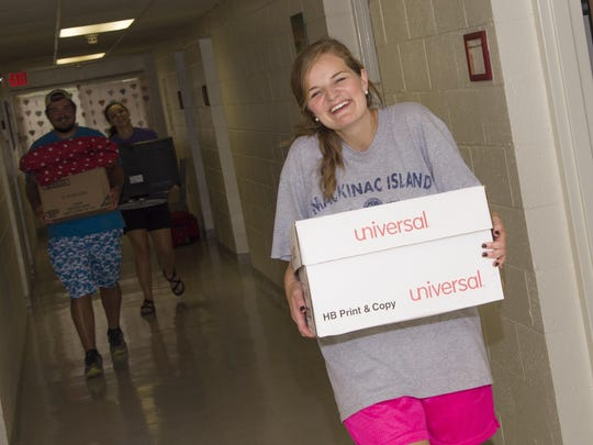 Volunteers offered helping hands as students moved their belongings into the residence halls.