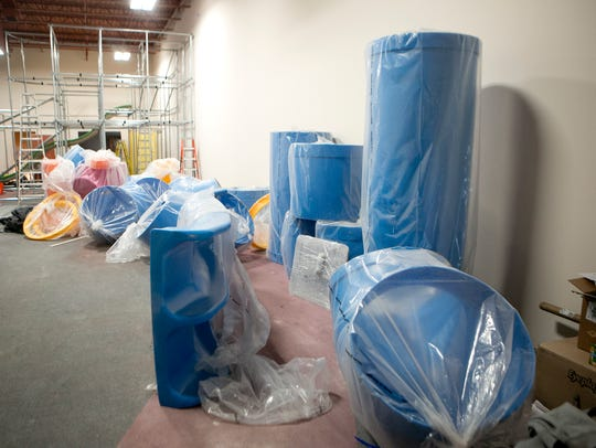 Equipment is wrapped in plastic during installation