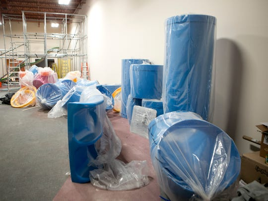 Equipment is wrapped in plastic during installation at the Blu Play Cafe in Wisconsin Rapids, Tuesday, Oct. 13, 2015.