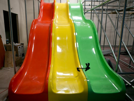 Three slides during the installation at the Blu Play Cafe in Wisconsin Rapids, Tuesday, Oct. 13, 2015.