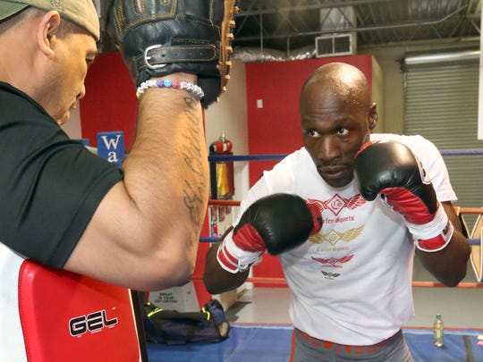 DeMarcus Corley, right, spars with Herman Delgado Sunday at Warriors Edge Boxing, 3465 Lee Blvd. Suite 233.