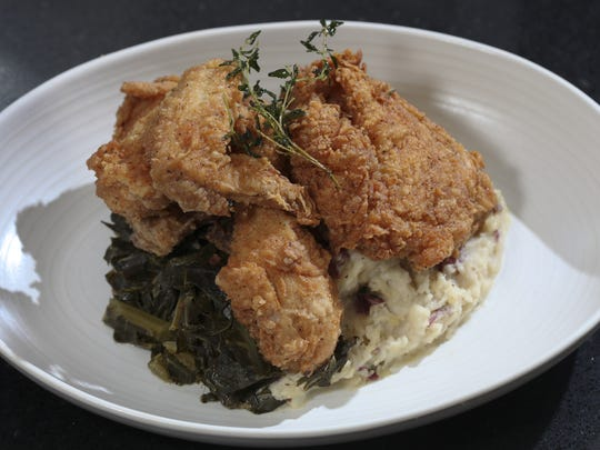 Southern Fried Chicken with collard greens and red skin mashed pototoes served at Sway.  May 9, 2012