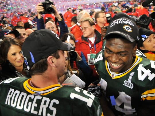 Green Bay Packers running back James Starks celebrates with quarterback Aaron Rodgers, left, after the Packers defeated the Pittsburgh Steelers in Super Bowl XLV at Cowboys Stadium in Arlington, Texas on Feb. 6, 2011.  Photo by Corey Wilson/Press-Gazette