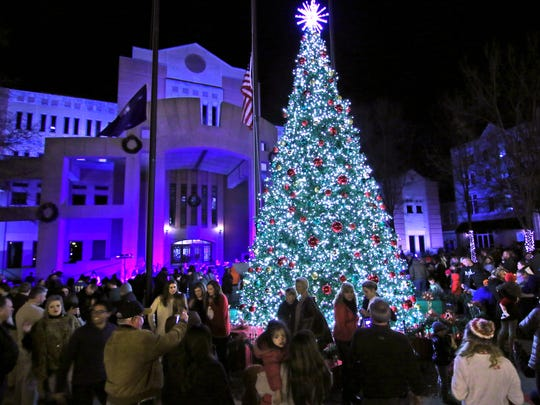 A crowd watches the Christmas Tree Lighting between