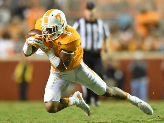Tennessee defensive back Todd Kelly Jr. (6) makes an interception against Oklahoma during the second half at Neyland Stadium on Saturday, Sept. 12, 2015 in Knoxville, Tenn. (ADAM LAU/NEWS SENTINEL)