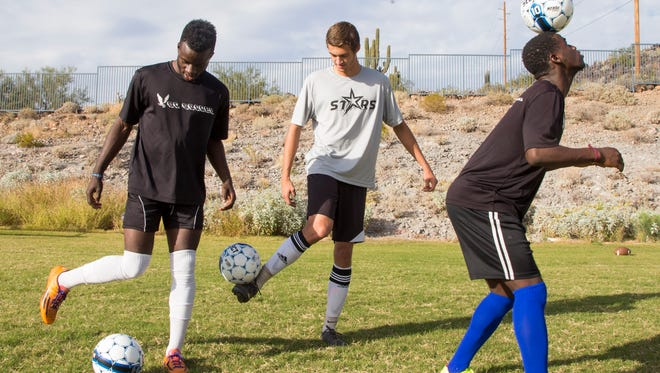 Sandra Day O'Connor's Jackson Jellah (left), Collin Jeambey (center) and Musa Morris are the stars of the boy's soccer team at Sandra Day O'Connor High School, the azcentral sports preseason No. 1 team in Division I boys soccer.