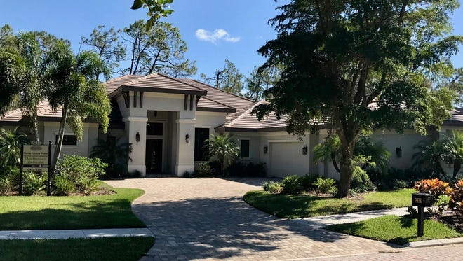 Florida Lifestyle Homes' move-in ready Casa Kam model in Quail West is unfurnished, priced at $1.39 million.