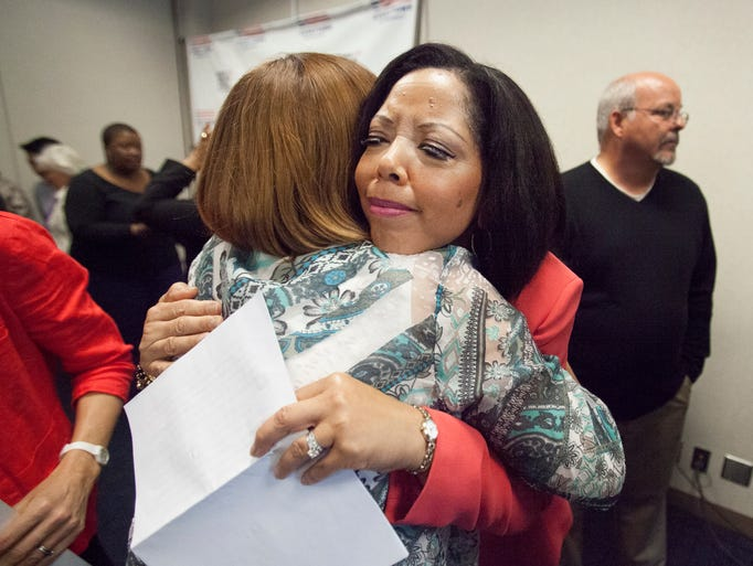 Lucia McBath, whose son Jordan Davis was killed receives a hug from Carol Gaxiola Friday, April 25, 2014 at the Everytown For Gun Safety Press Conference.  Gaxiola's daughter Jasmine, from Tucson, Arizona, was murdered in 1999.