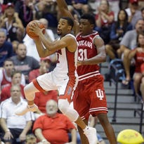 UNLV guard Jerome Seagears (2) passes the ball as Indiana center Thomas Bryant (31) defends in the first half during an NCAA college basketball game in the Maui Invitational Wednesday, Nov. 25, 2015, in Lahaina, Hawaii.