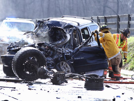 Emergency personnel attempt to access the driver of a car that was involved in a head-on collision with a pickup truck on Route 526 in Upper Freehold Thursday afternoon, April 6, 2017.