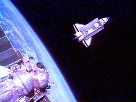 This snapshot from a video view of the space shuttle
