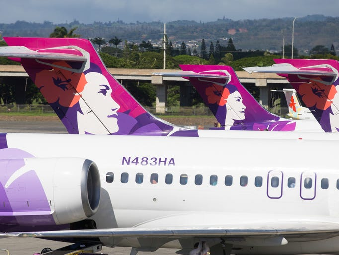 Hawaiian Airlines Boeing 717 jets park at the inter-island