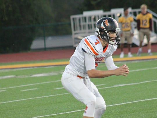 City offense leader Jay Volpenhein takes the shotgun snap for Anderson Oct. 13 against Turpin.