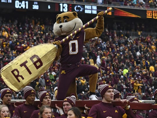 MINNEAPOLIS, MINNESOTA - NOVEMBER 09: The Minnesota Golden Gophers mascot and cheerleaders parade on the field as they play against the Penn State Nittany Lions during the third quarter at TCFBank Stadium on November 09, 2019 in Minneapolis, Minnesota. (Photo by Hannah Foslien/Getty Images) ORG XMIT: 775389792 ORIG FILE ID: 1186573079