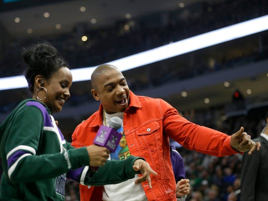 Ja Rule, right, dances during the first half of an NBA basketball game between the Milwaukee Bucks and the Minnesota Timberwolves Saturday, Feb. 23, 2019, in Milwaukee. (AP Photo/Aaron Gash) ORG XMIT: WIAG1