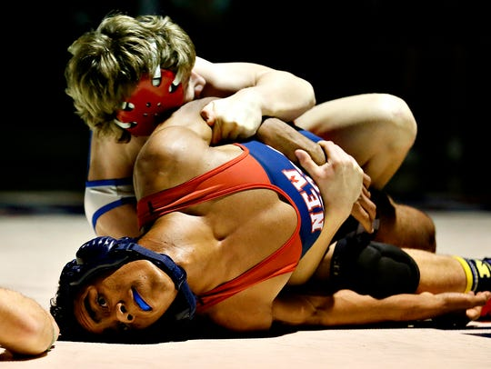Spring Grove's Chance Jackson, back, wrestles New Oxford's