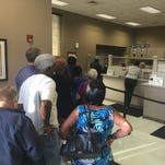 Mississippi Power's Biloxi customer service office was busy shortly after opening at 8 a.m. Oct. 12. More than 25 customers were in line outside when the doors opened.